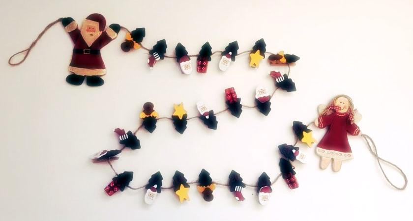 Adventskalender Schnur mit dekorativen Wäscheklammern.